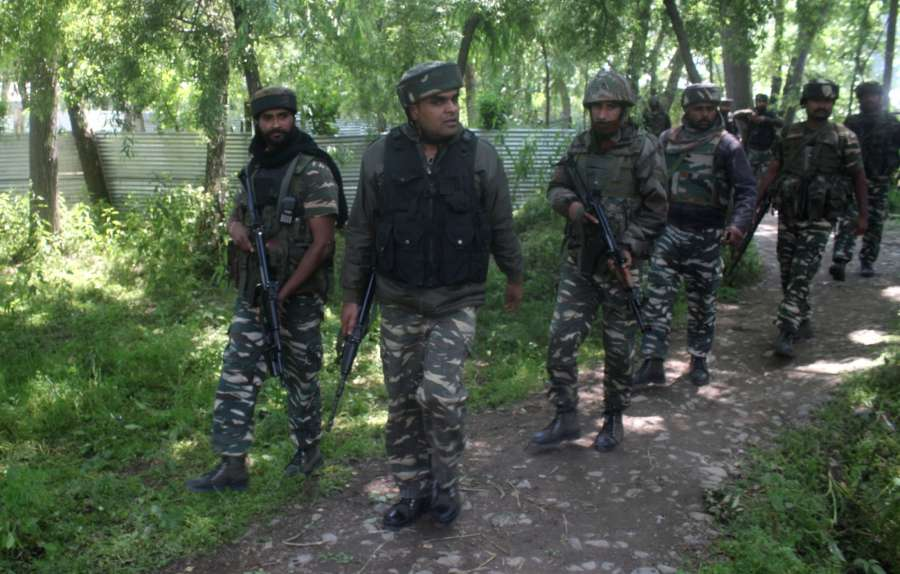 Pulwama: Soldiers during an encounter with militants in Pulwama on May 27, 2017. Hizbul Mujahideen commander, Sabzar Bhat who succeeded slain militant, leader Burhan Wani, was killed along with another militant in the gunfight. (Photo: IANS) by .