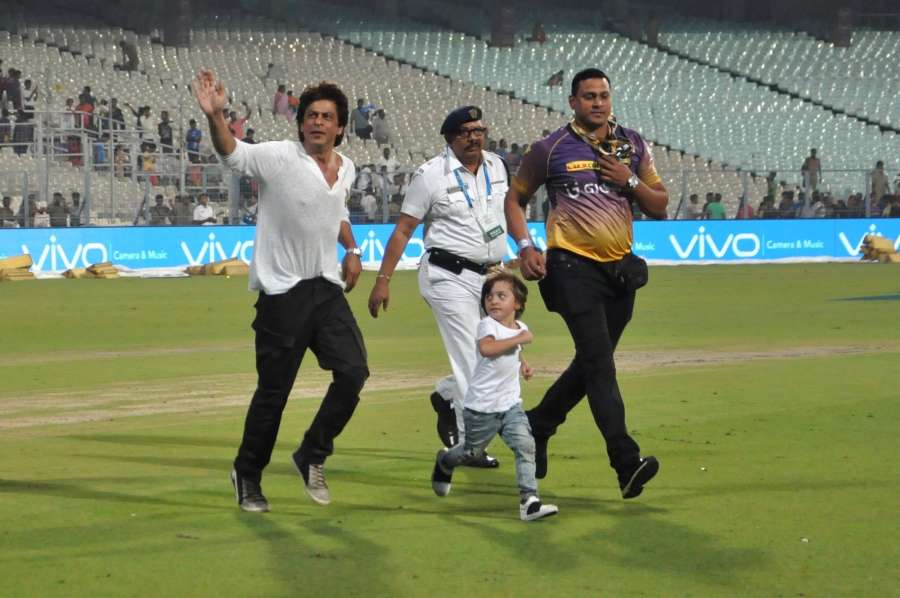 Kolkata: Actor Shah Rukh Khan with his son AbRam at the Eden Gardens in Kolkata on May 13, 2017. (Photo: Kuntal Chakrabarty/IANS) by .