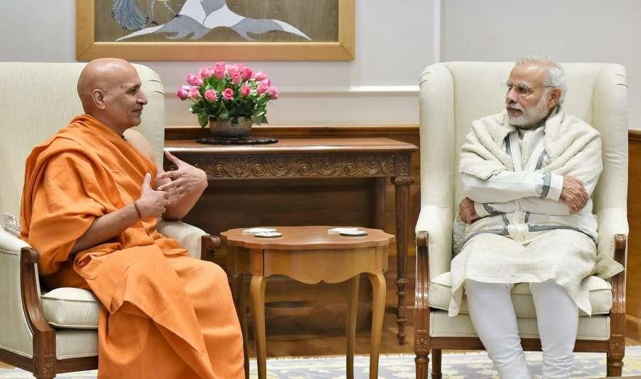 New Delhi: Head of the Mokshayatan Yog Sansthan, Saharanpur, Swami Dr. Bharat Bhushan calls on the Prime Minister Narendra Modi in New Delhi on Jan 6, 2017. (Photo: IANS/PIB) by .