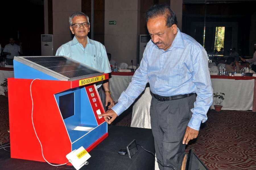 """Kolkata: Union Science and Technology Minister Harsh Vardhan demonstrates Bio-Solar ATM during """"DST Conclave 2017"""" in Kolkata on May 3, 2017. (Photo: Kuntal Chakrabarty/IANS) by ."""