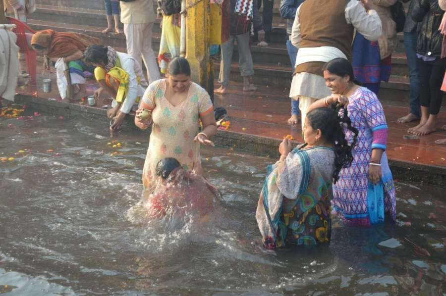 Mathura: Women take dip in the Yamuna river on Makar Sankranti in Mathura, on Jan 14, 2017. (Photo: IANS) by .
