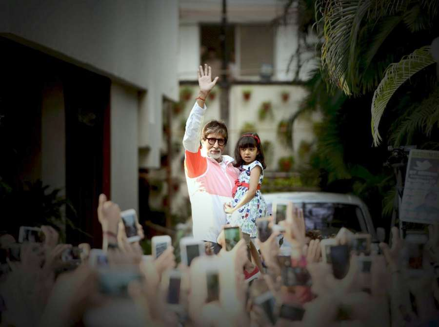 Mumbai: A picture shared by actor Amitabh Bachchan on twitter where he is seen waving at his fans along with his grand daughter Aaradhya Bachchan, in Mumbai on May 28, 2017. by .