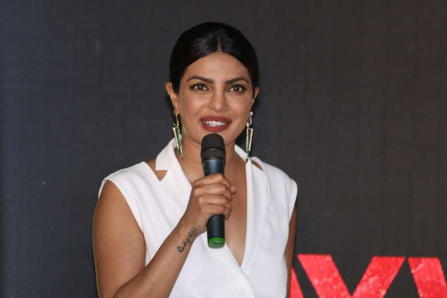"Caption : Mumbai:Actress Priyanka Chopra during a programme organised to promote of her upcoming Hollywood film ""Baywatch"" in Mumbai on April 26, 2017. The film is schedule to release in India on May 26th.(Photo: IANS) by ."