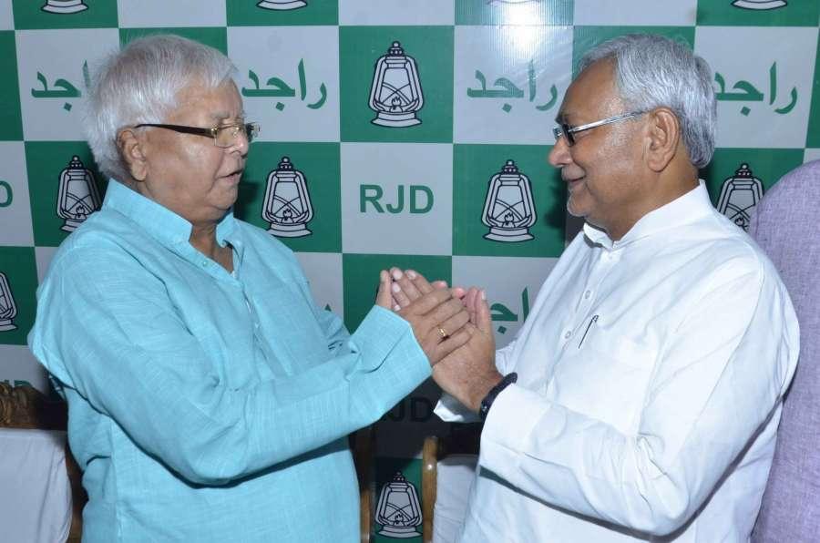 Patna: Bihar Chief Minister Nitish Kumar greets RJD supremo Lalu Prasad Yadav on his birthday in Patna on June 11, 2017. (Photo: IANS) by .