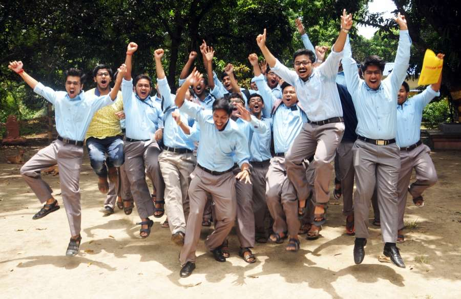 Kolkata: Students celebrate after declaration of results of higher secondary exams conducted by West Bengal Council for Higher Secondary Education (WBCHSE) in Kolkata on May 30, 2017. (Photo: IANS) by .