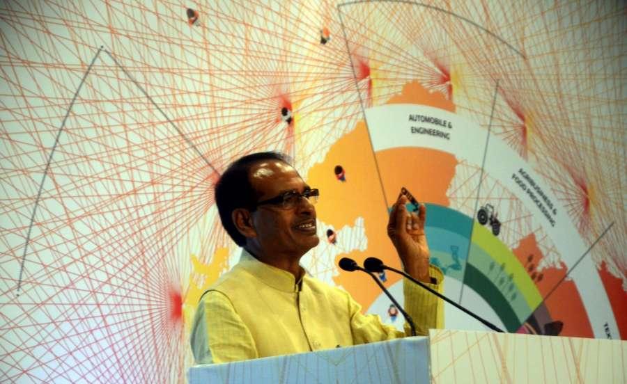 "Mumbai: Madhya Pradesh Chief Minister Shivraj Singh Chouhan addresses during a CII seminar on ""Investment Opportunities in Madhya Pradesh"" in Mumbai on Aug 12, 2016. (Photo: IANS) by ."