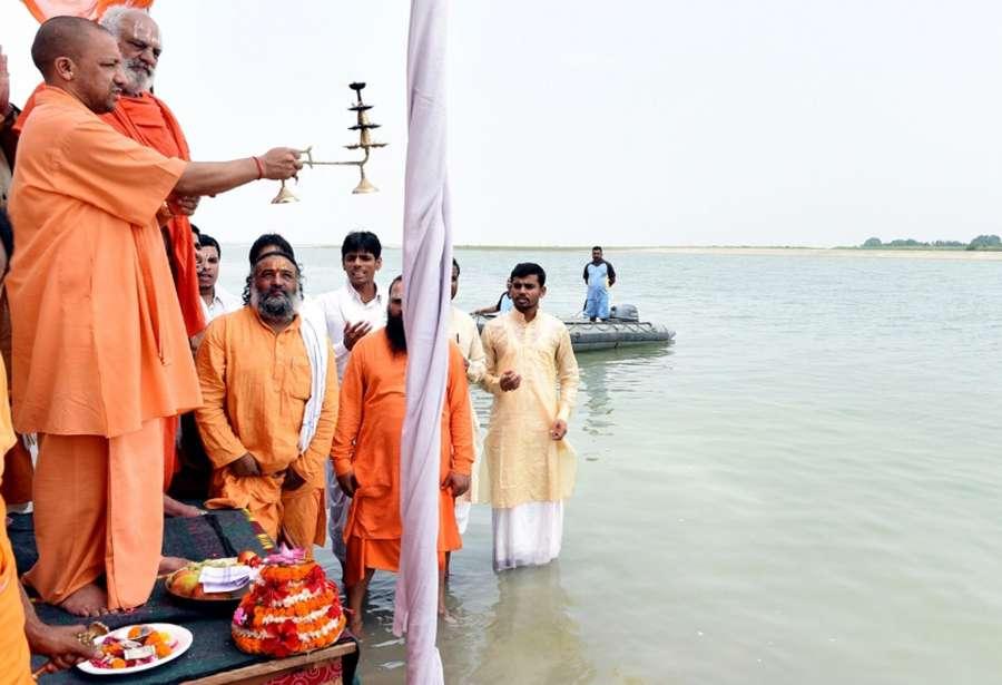 Ayodhya: Uttar Pradesh Chief Minister Yogi Adityanath offer prayers at the Saryu river in Ayodhya, Uttar Pradesh on May 31, 2017. (Photo: IANS) by .