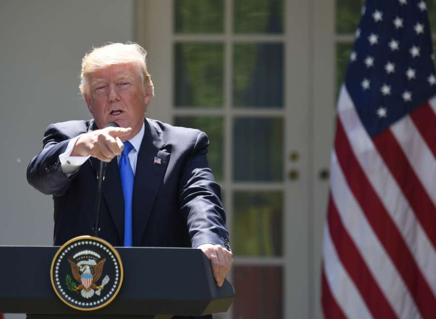 """WASHINGTON, June 9, 2017 (Xinhua) -- U.S. President Donald Trump attends a joint press conference with visiting Romanian President Klaus Iohannis (not in the picture) at the White House in Washington D.C., the United States, on June 9, 2017. During the press conference, U.S. President Donald Trump accused Qatar of funding terrorism """"at a very high level,"""" urging the Gulf Arab country to stop the funding. (Xinhua/Yin Bogu/IANS) by ."""