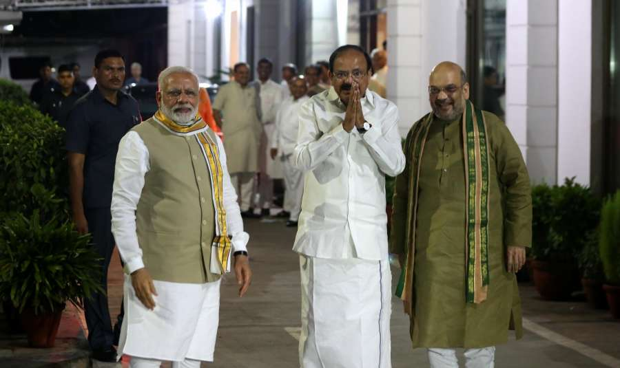 New Delhi: Prime Minister Narendra Modi with BJP chief Amit Shah and NDA's candidate for the August 5 Vice Presidential election M. Venkaiah Naidu at BJP headquarters in New Delhi, on July 17, 2017. (Photo: IANS) by .