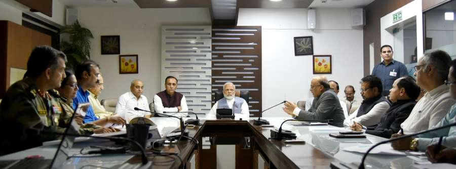New Delhi: Prime Minister Narendra Modi takes a meeting on the situation arising out of incessant rain and floods in different parts of Gujarat in Ahmedabad on July 25, 2017. Also seen Gujarat Chief Minister Vijay Rupani and Gujarat Deputy Chief Minister Nitinbhai Patel. (Photo: IANS/PIB) by .