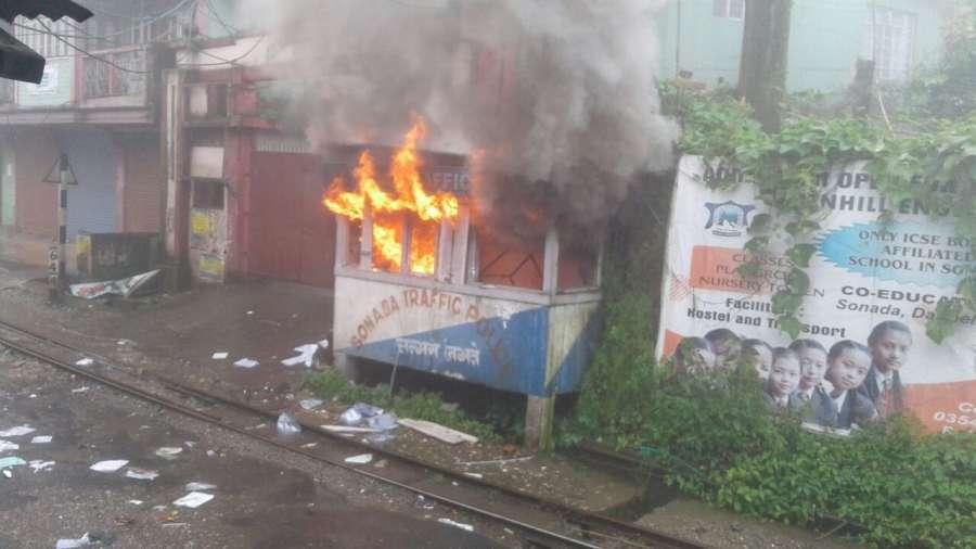 Darjeeling: Gorkha Janmukti Morcha supporters set a police outpost ablaze after a pro-Gorkhaland supporter shot dead at Sonada in Darjeeling on July 8, 2017. (Photo: IANS) by .