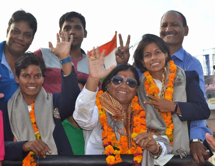 Agra: Indian women cricketers Deepti Sharma, Poonam Yadav along with coach Hemlata Kala and family members during a road show in Agra on July 28, 2017. (Photo: Pawan Sharma/IANS) by .