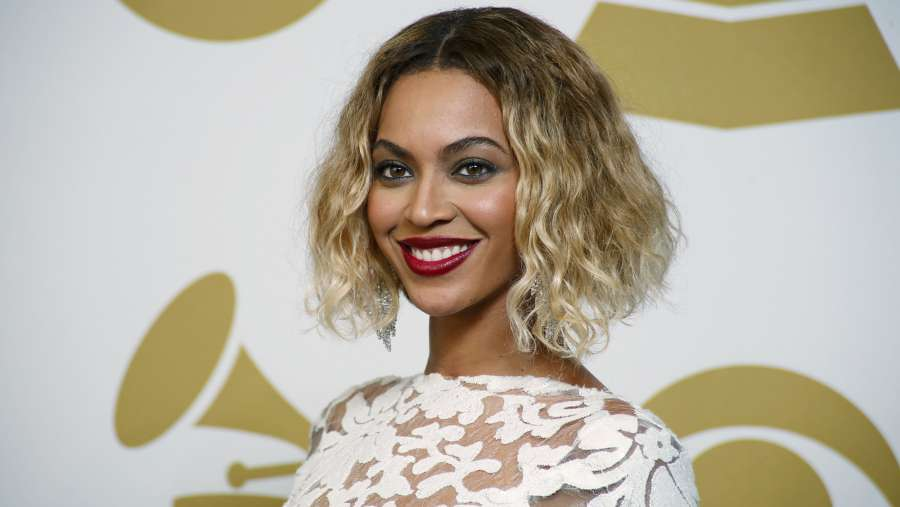 Image: Beyonce poses backstage after performing at the 56th annual Grammy Awards in Los Angeles by .