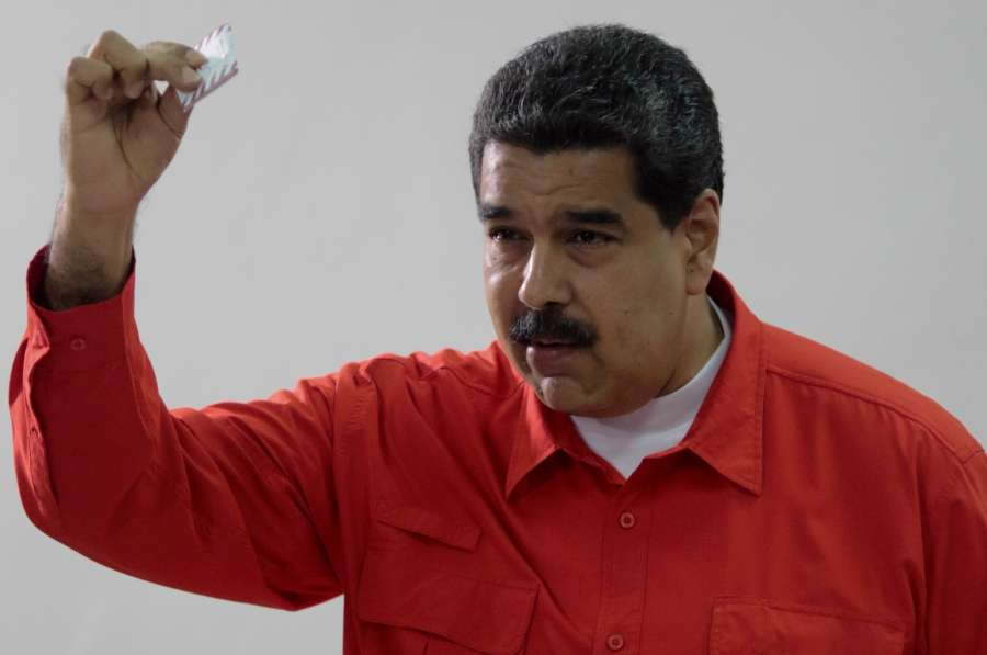 CARACAS, July 30, 2017 (Xinhua) -- Venezuelan President Nicolas Maduro casts his vote during the election for the National Constituent Assembly (ANC), in Caracas, Venezuela, on July 30, 2017. All the polling stations for electing members to the National Constituent Assembly in Venezuela opened at 6:00 a.m. local time (1030 GMT) on Sunday, despite opposition-led protests against the move. (Xinhua/Presidency of Venezuela/IANS) by .