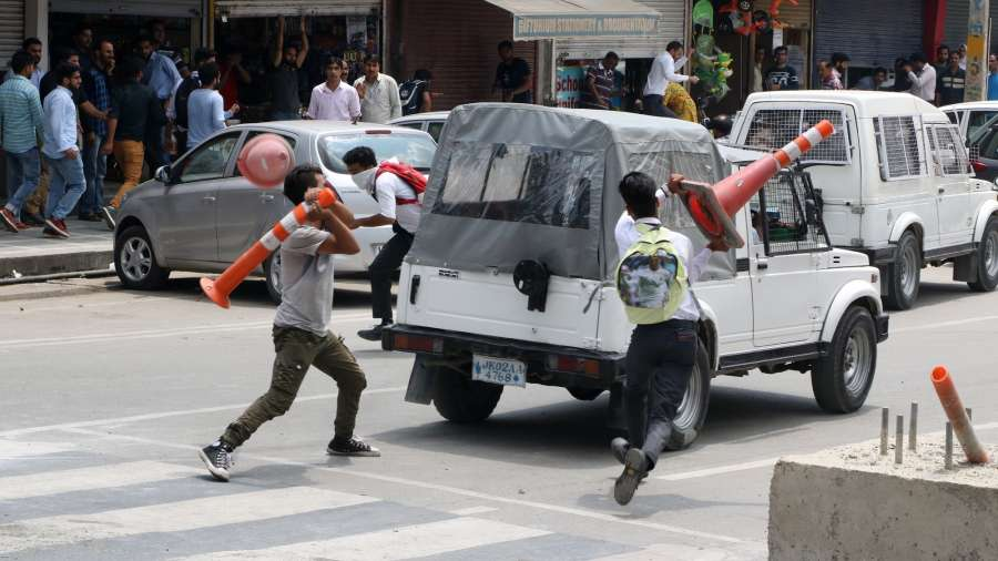 Srinagar: Students attack a vehicle belonging to security personnel in Srinagar after a top Pakistani militant who carried a reward of Rs 15 lakh on his head was killed along with a local associate in fighting with security forces on Aug 1, 2017. (Photo: IANS) by .