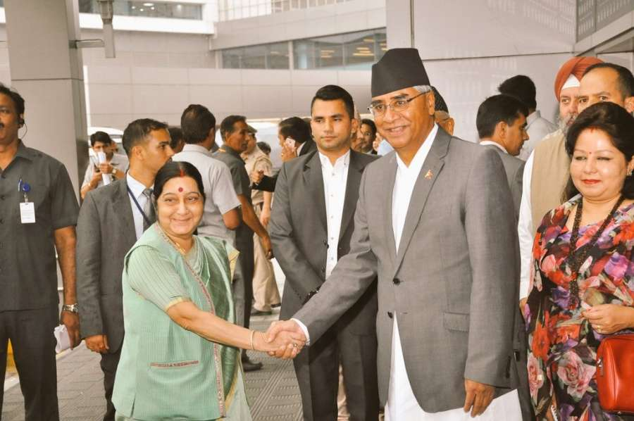 New Delhi: External Affairs Minister Sushma Swaraj receives Nepal Prime Minister Sher Bahadur Deuba on his arrival in New Delhi on Aug. 23, 2017. (Photo: IANS/Twitter@MEAIndia) by .