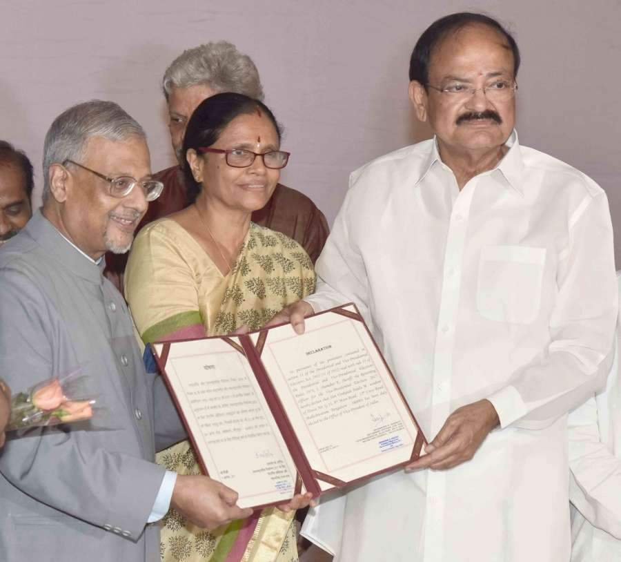 New Delhi: Returning Officer of the Vice-Presidential Election-2017 and Secretary-General of Rajya Sabha Shumsher K. Sheriff presents the declaration of result for the election for the Vice President of India to the Vice President-elect M Venkaiah Naidu, in New Delhi on Aug 5, 2017. (Photo: IANS/PIB) by .