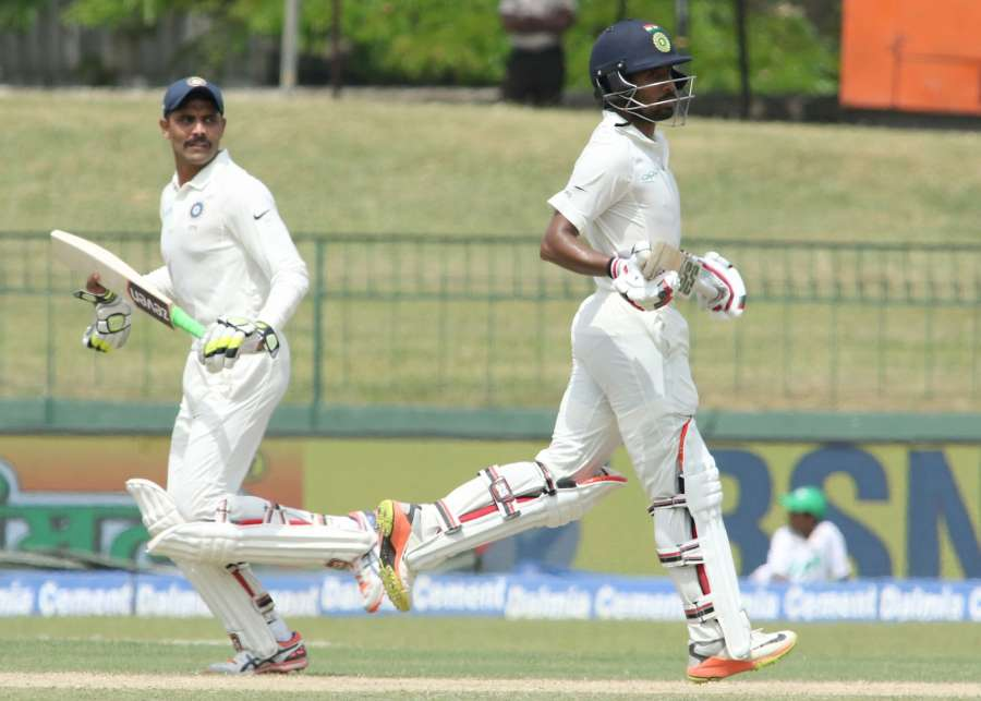 Colombo: India's Wriddhiman Saha and Ravindra Jadeja on Day 2 of the second test match between India and Sri Lanka at Sinhalese Sports Club Ground in Colombo, Sri Lanka on Aug 4, 2017. (Photo: Surjeet Yadav/IANS)​ by .