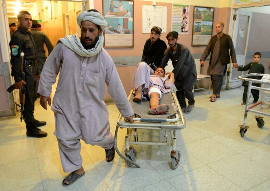 KANDAHAR, May 17 (Xinhua) -- People carry an injured man at a local hospital in Kandahar province, Afghanistan, May 16, 2017. One civilian was killed and one dozen people wounded after a twin blasts rocked Kandahar city, capital of Afghanistan's southern province of Kandahar Tuesday night, the provincial government spokesman said on Wednesday. (Xinhua/Sanaullah Seiam/IANS) by .