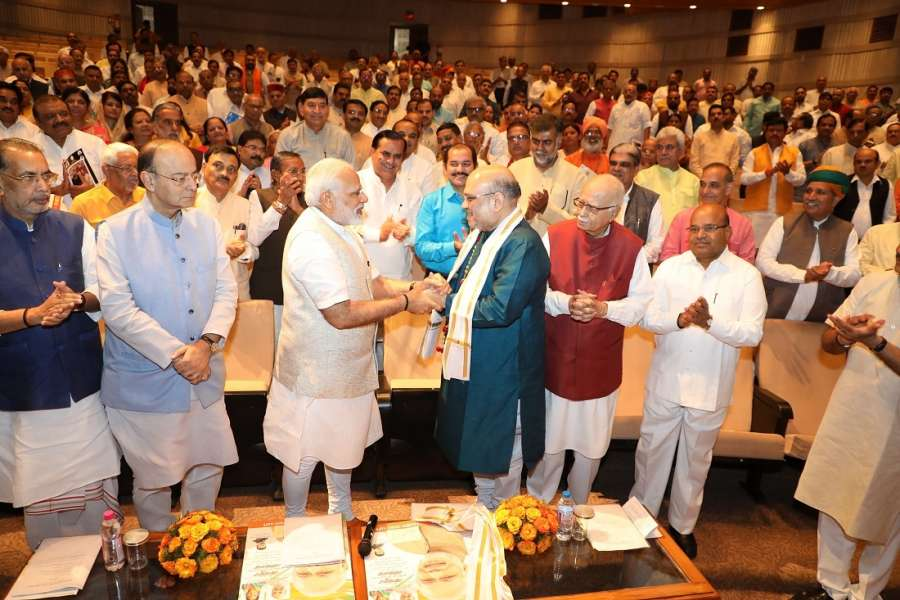 New Delhi: Prime Minister Narendra Modi felicitates BJP president Amit Shah who completed his three years as BJP president and has been elected to the Rajya Sabha during BJP parliamentary meeting in New Delhi on Aug 10, 2017. (Photo: IANS) by .