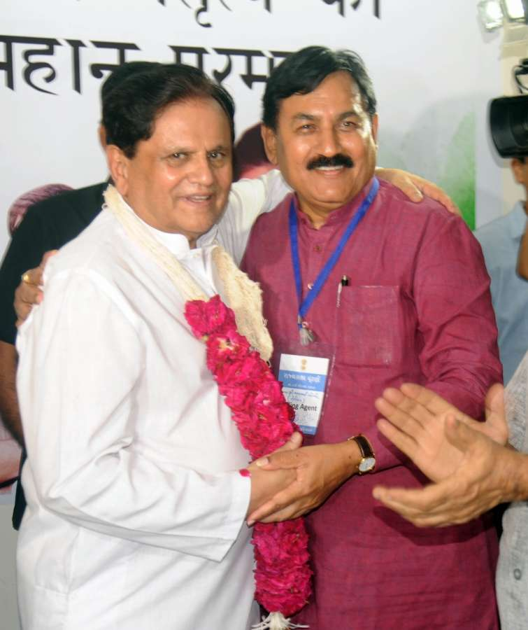 Gandhinagar: Ahmed Patel, political aide to the Congress president Sonia Gandhi being greeted by Congress polling agent after winning the Rajya Sabha election in Gandhinagar on Aug 9, 2017. (Photo: IANS) by .