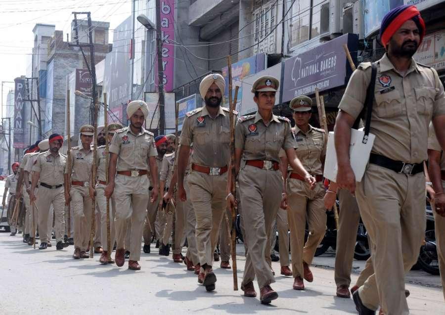 Bathinda: Punjab police personnel conduct flag march ahead of the Aug 25 verdict of the CBI court in the rape case against Dera Saccha Sauda chief Gurmeet Ram Rahim Singh in Bathinda on Aug 23, 2017. (Photo: IANS) by .