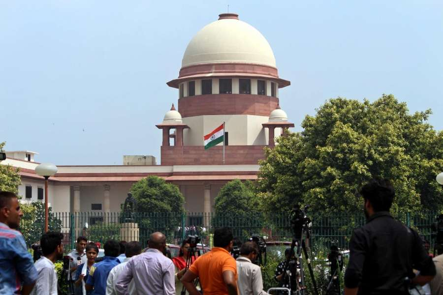 """New Delhi: Media persons outside the Supreme Court during the court's hearing on Triple Talaq in New Delhi on Aug 22, 2017. The Supreme Court struck down the practice of Triple Talaq terming it """"unconstitutional"""", """"arbitrary"""" and """"not part of Islam."""" (Photo: IANS) by ."""