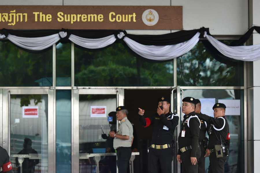 BANGKOK, Aug. 25, 2017 (Xinhua) -- Policemen stand in front of the Supreme Court of Thailand, in Bangkok, capital of Thailand, on Aug. 25, 2017. The Supreme Court of Thailand on Friday postponed the verdict in former Prime Minister Yingluck Shinawatra's rice pledging case to Sept. 27 as she failed to show up at the court, and the court issued an arrest warrant against her. (Xinhua/Li Mangmang/IANS) by .