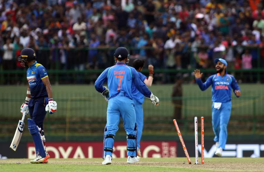 Pallekele: India's wicket keeper Mahendra Singh Dhoni breaks the stumps to dismiss Sri Lanka's Danushka Gunathilaka during the 2nd ODI match between India and Sri Lanka in Pallekele, Sri Lanka on Aug 24, 2017. (Photo: Surjeet Yadav/IANS) by .