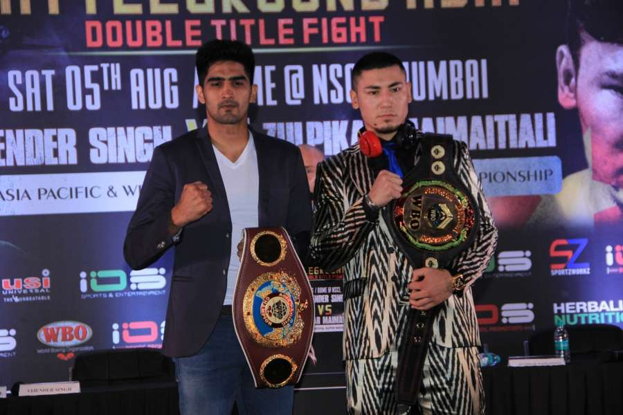 Mumbai: WBO Asia Pacific Super Middleweight champion Vijender Singh and WBO Oriental Super Middleweight champion Zulpikar Maimaitiali during a press conference regarding 'Battleground Asia' in Mumbai, on June 27, 2017. (Photo: IANS) by .