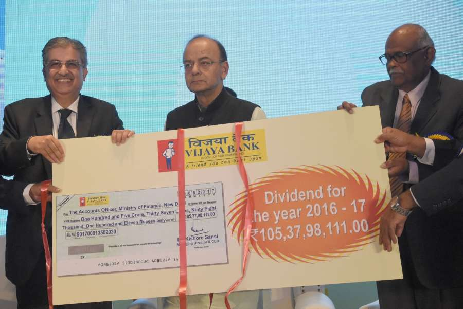 Bengaluru: Union Finance and Defence Minister Arun Jaitley and Vijaya Bank MD and CEO Dr. Kishore Sansi during the launch of Vijaya Bank's 100 Digital Villages, 100 Branches and 100 ATMs, in Bengaluru on Aug 26, 2017. (Photo: IANS) by .