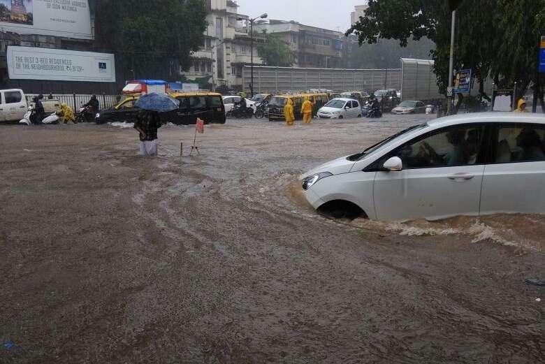 Mumbai: Vehicles struggle through the waterlogged streets after rains lashed Mumbai on Aug 29, 2017. (Photo: IANS) by .