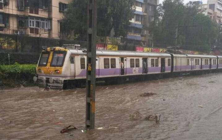 Mumbai: A view of the waterlogged railway tracks after rains lashed Mumbai on Aug 29, 2017. (Photo: IANS) by .