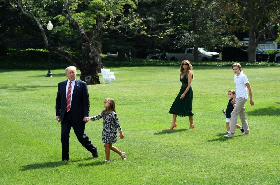 WASHINGTON, Aug. 25, 2017 (Xinhua) -- U.S. President Donald Trump (1st L), First Lady Melania Trump (C), their son Barron (1st R) and Trump's grandchildren Arabella (2nd L) and Joseph walk to board the Marine One en route to Camp David for the weekend, at the south lawn of the White House in Washington D.C., the United States, on Aug. 25, 2017. White House Press Secretary Sarah Huckabee Sanders told a briefing Friday that U.S. President Donald Trump, who left for David Camp, plans to visit U.S. state of Texas sometime early next week as Hurricane Harvey nears southern coastal states. (Xinhua/Yin Bogu/IANS) by .