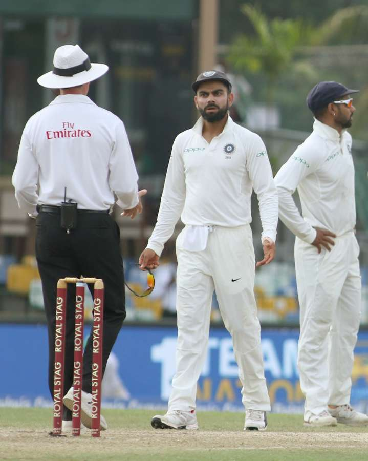Colombo: Indian skipper Virat Kohli interacts with umpire after appalling for review of Sri Lanka's batsman Kusal Mendis on Day 2 of the second test match between India and Sri Lanka at Sinhalese Sports Club Ground in Colombo, Sri Lanka on Aug 4, 2017. (Photo: Surjeet Yadav/IANS)​ by .