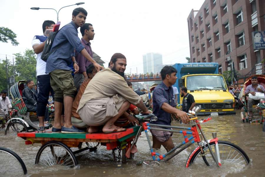 DHAKA, July 26, 2017 (Xinhua) -- People wade through a water-logged road after heavy rains in Dhaka, Bangladesh, July 26, 2017. (Xinhua/Salim Reza/IANS) by .
