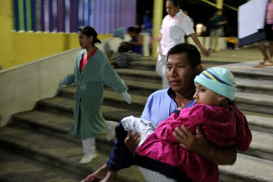 CHIAPAS, Sept. 8, 2017 (Xinhua) -- A man carries a girl in his arms after being evacuated from the Pediatric Hospital in Tuxtla Gutierrez, Chiapas state, Mexico, on Sept. 8, 2017. At least nine people were killed in a powerful earthquake measuring 8.0 on the Richter scale that struck off Mexico's southern coast late Thursday, local authorities said. (Xinhua/Rene Arauxo/IANS) by .