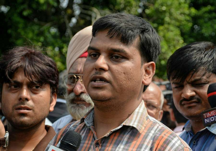 New Delhi: Father of the class 2 student Pradhuman who was found dead by a school staff in Ryan international School's washroom with his throat slit, talks to the press outside the Supreme Court in New Delhi on Sept 11, 2017. (Photo: IANS) by .