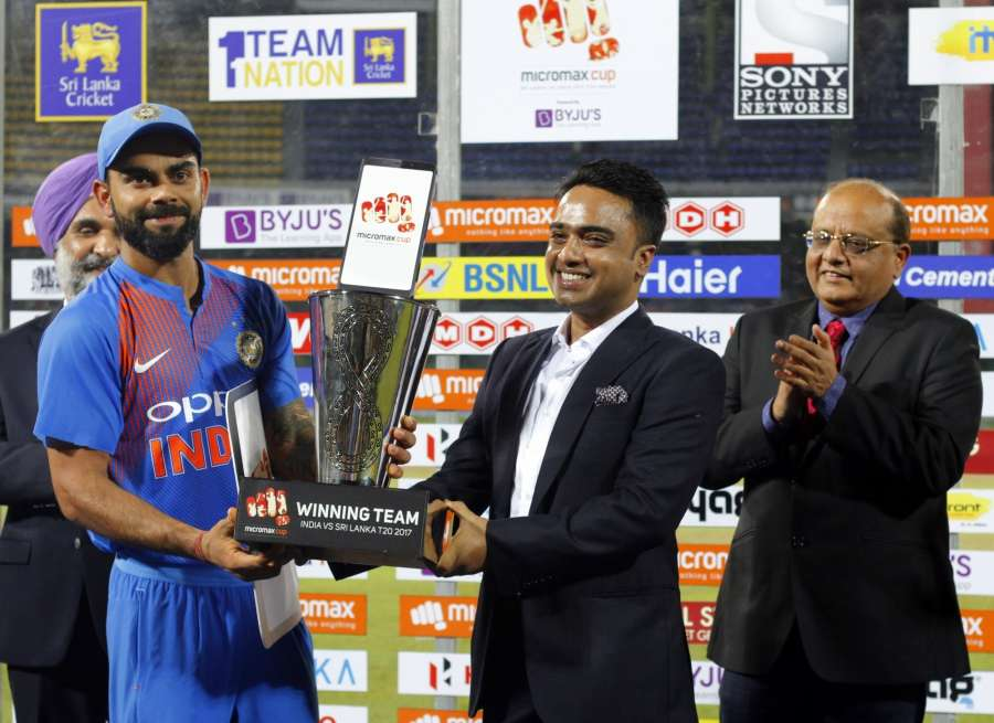 Colombo: Indian skipper Virat Kohli with the winner's trophy after winning the T20I match against Sri Lanka at R.Premadasa Stadium in Colombo, Sri Lanka on Sept 6, 2017. (Photo: Surjeet Yadav/IANS) by .