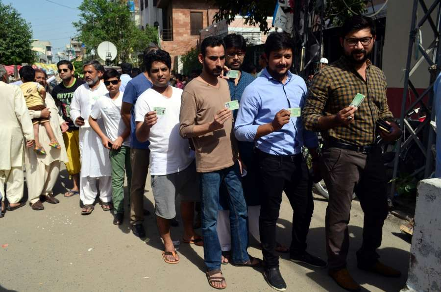 LAHORE, Sept. 18, 2017 (Xinhua) -- People show their identity cards as they wait in a queue to cast their votes during the parliamentary by-election in eastern Pakistan's Lahore, on Sept. 17, 2017. Ousted Pakistani Prime Minister Nawaz Sharif's wife Kulsoom Nawaz has won parliamentary seat in a neck-and-neck by-election, according to unofficial results announced early Monday. (Xinhua/Jamil Ahmed/IANS) by .