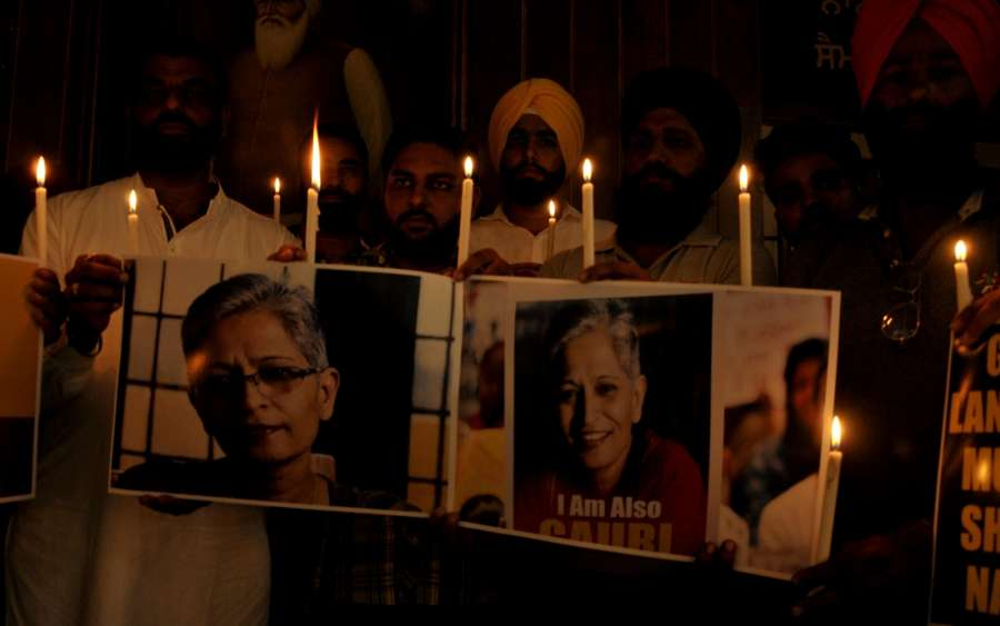 Amritsar: National Human Rights and Crime Control Organisation members participate in a candle light vigil to condemned the killing of Bengalaru journalist-turned-activist Gauri Lankesh in Amritsar on Sept 8, 2017. (Photo: IANS) by .
