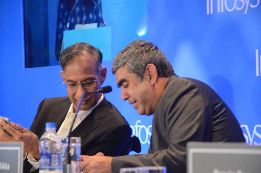 Mumbai: Infosys Chairman R Seshasayee and CEO Vishal Sikka addresses during a press conference in Mumbai on Feb 13, 2017. (Photo: Sandeep Mahankal/IANS) by .
