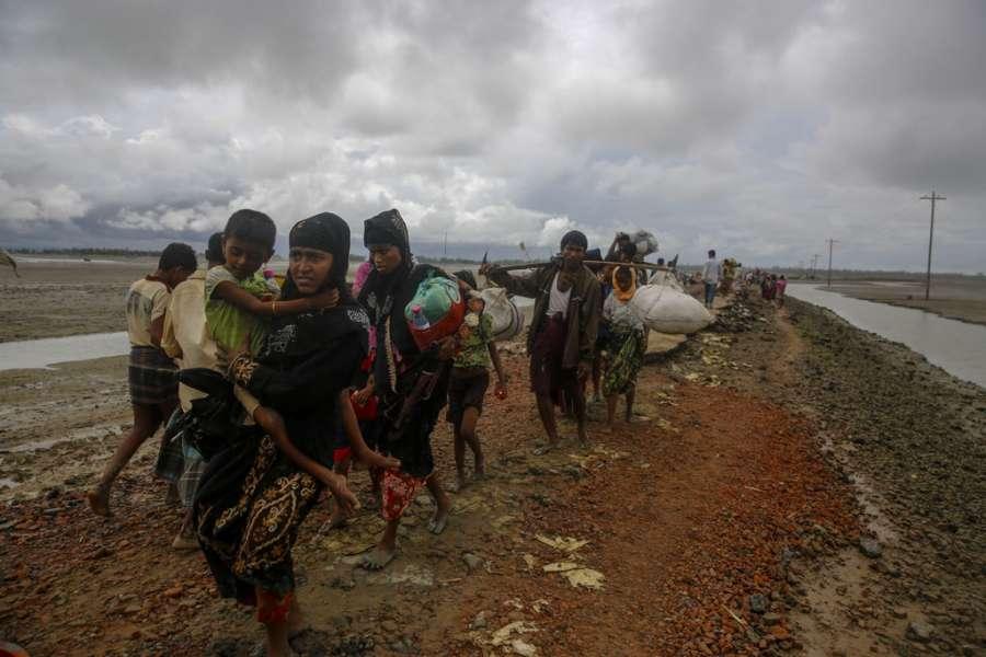 Dakhinpara: Rohingya refugees arrive at Shah Porir Dwip in Dakhinpara ofBangladesh from Rasidong in Myanmar, on Sept 13, 2017. (Photo: bdnews24/IANS) by .