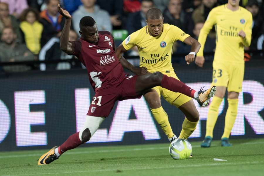 METZ, Sept. 9, 2017 (Xinhua) -- Kylian Mbappe (R) of Paris Saint Germain competes with Moussa Niakhate of Metz during their match of French Ligue 1 2017-2018 season 5th round in Metz, France on Sept. 8, 2017. Paris Saint Germain won 5-1. (Xinhua/Jack Chan/IANS) by .