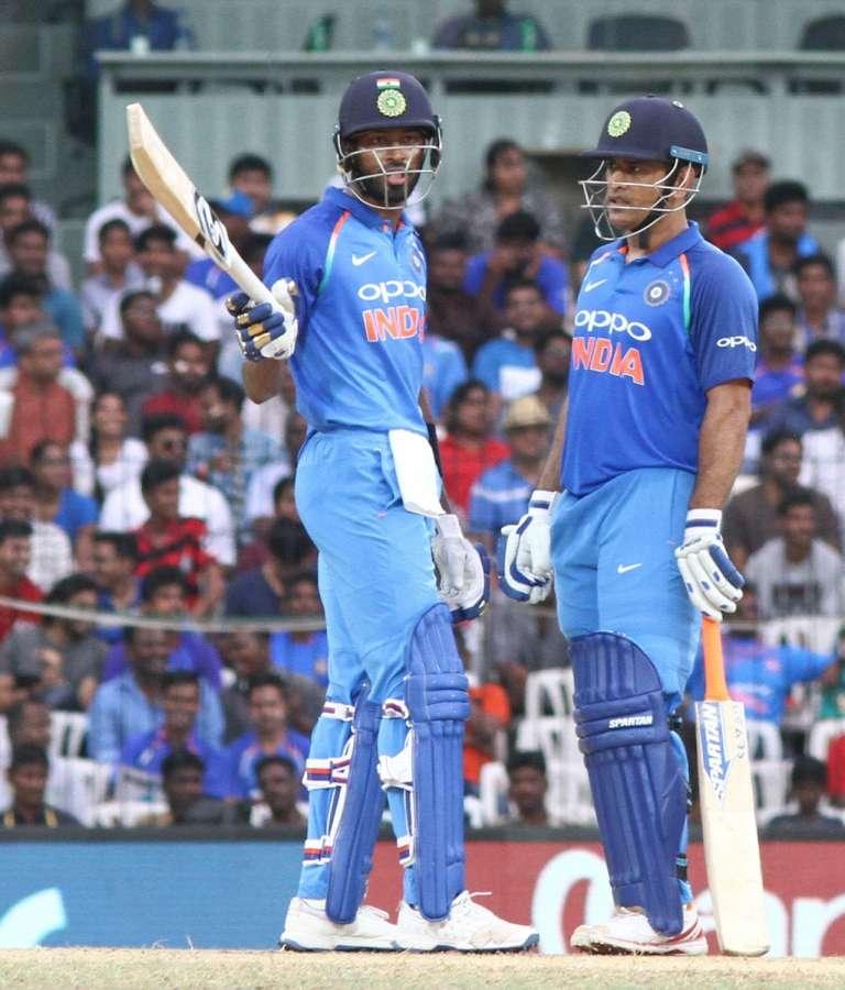 Chennai: India's Hardik Pandya celebrates his half century along with MS Dhoni during the first ODI cricket match between India and Australia at MA Chidambaram Stadium in Chennai on Sept 17, 2017. (Photo: IANS) by .