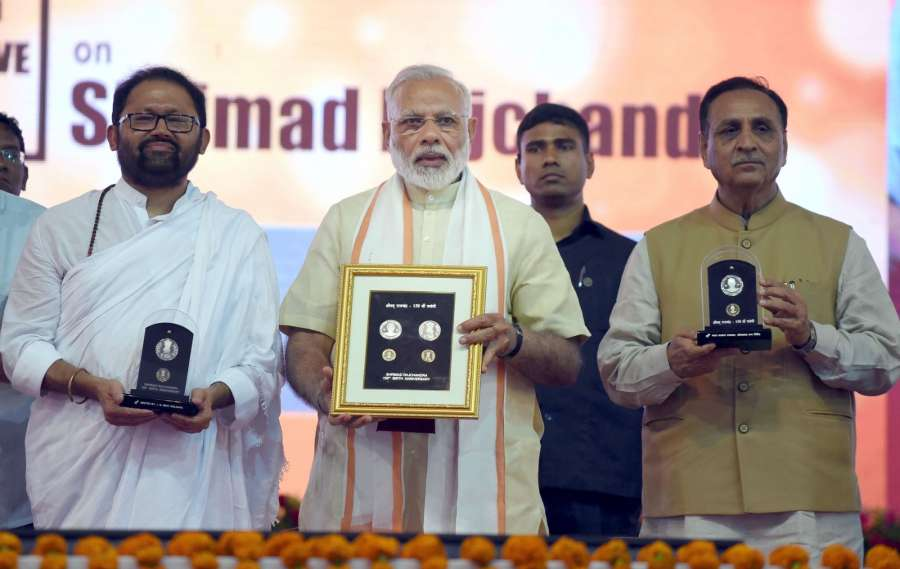 Ahmedabad: Prime Minister Narendra Modi releases commemorative coin on Shrimad Rajchandraji at Sabarmati Ashram in Ahmedabad on June 29, 2017. Also seen Gujarat Chief Minister Vijay Rupani. (Photo: IANS/PIB) by .