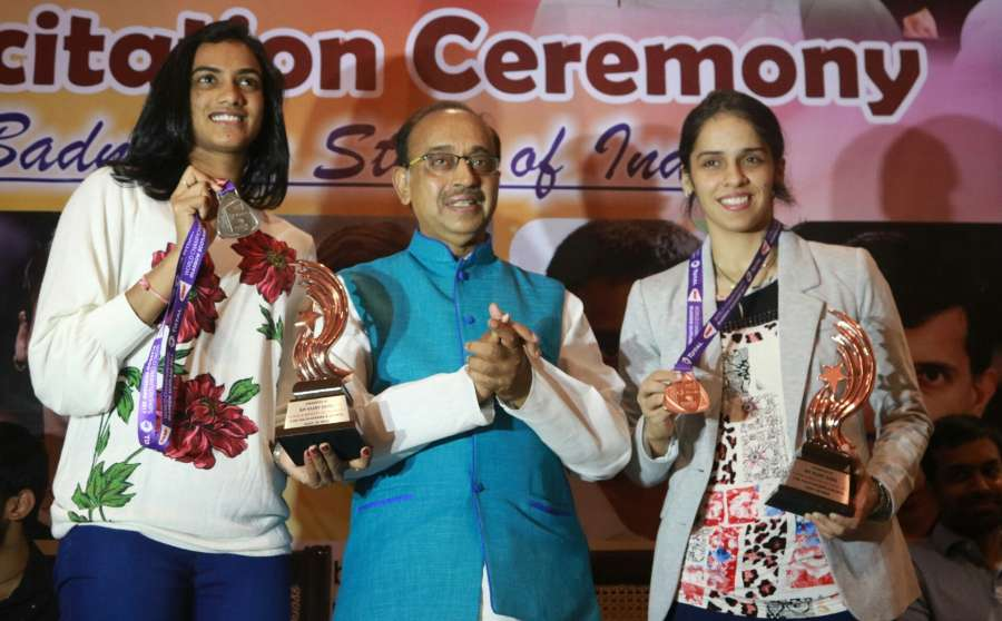 New Delhi: Union Sports Minister Vijay Goel along with Indian shuttlers P.V. Sindhu and Saina Nehwal during a felicitation ceremony in New Delhi on Aug 31, 2017. (Photo: IANS) by .