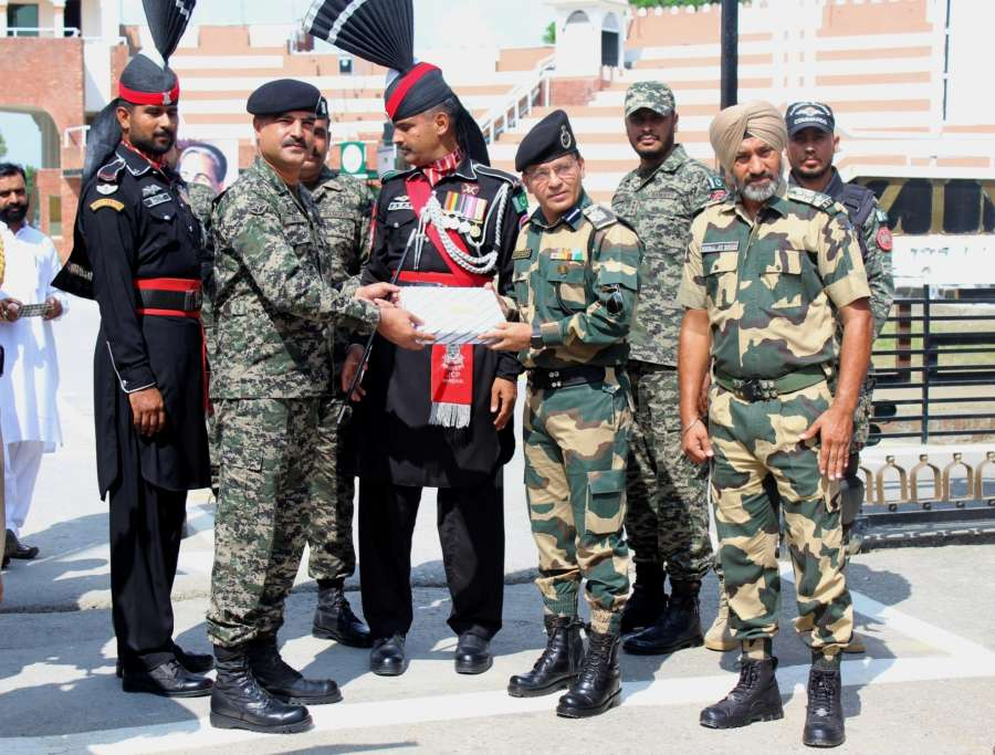Attari: BSF and Pakistani Rangers exchange sweets on Eid al-Adha at Attari-Wagha border near Amritsar on Sept 2, 2017. (Photo: IANS) by .
