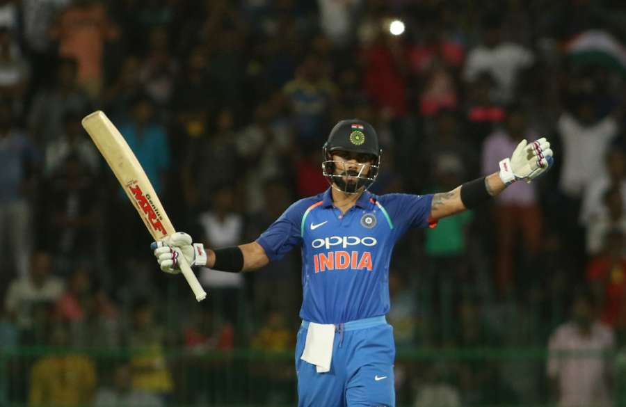 Indian skipper Virat Kohli celebrates his century during the fifth ODI match between India and Sri Lanka at R.Premadasa Stadium in Colombo, Sri Lanka on Sept 3, 2017. (Photo: Surjeet Yadav/IANS) by .