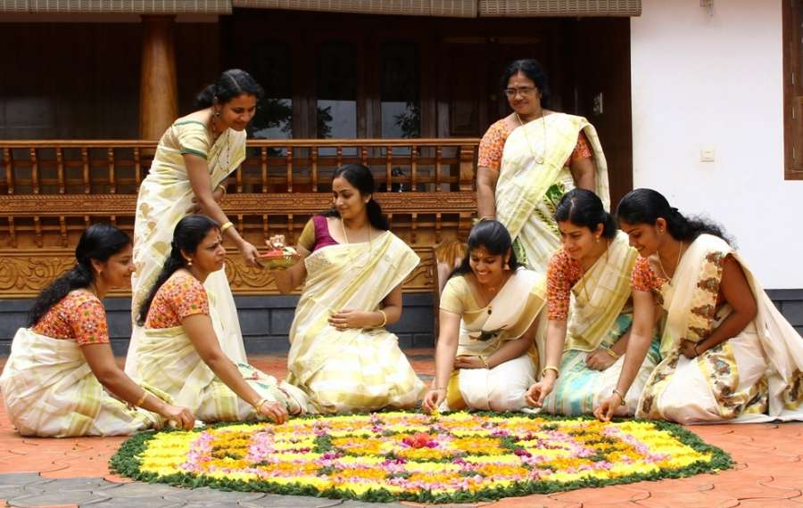 "Bengaluru: Women make ""pookalam"" - a rangoli made from flowers ahead of Onam in Bengaluru on Sept 2, 2017. (Photo: IANS) by ."